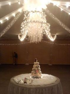 Hula hoop chandelier with icicle lights add a little tulle it turned out beautiful !