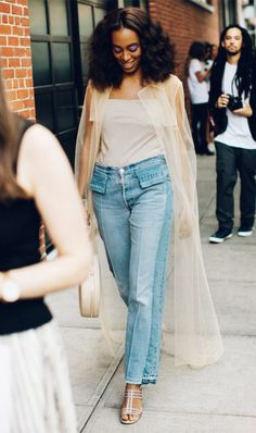 How to wear mom jeans: Solange Knowles wearing a tulle jacket and sandals