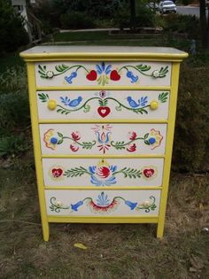 I like the Penn Dutch inspired design on this painted chest of drawers.