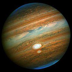 Close Encounter of Jupiter's Red Spots
