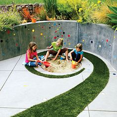 Not interested in the sandbox. In love with the swirl of grass through the concrete.