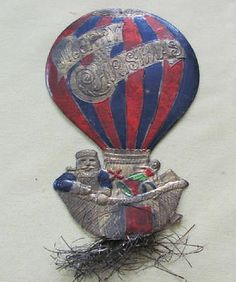 Antique embossed Dresden Santa in hot air balloon with toys and tinsel