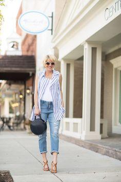 Seersucker + Saddles. White tank top+white and blue striped vest+girlfriend jeans+cognac sandals+black handbag+white sunglasses. Summer Casual Outfit 2017