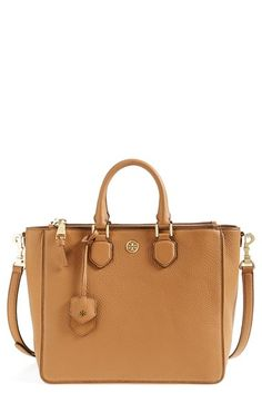 A smart, structured silhouette adds uptown sophistication to a pebbled-leather tote...