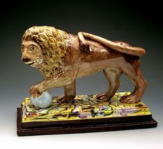 ANTIQUE STAFFORDSHIRE POTTERY PEARLWARE FIGURE LION  c1820      WITH SPECTACULAR...
