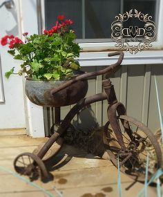 flower pots from junk, container gardening, flowers, gardening, repurposing upcycling, Here I took my husband s childhood tricycle that the bus hit and knocked the seat off of By replacing the seat with a metal bowl I found the opportunity to bring this baby to the forefront each season
