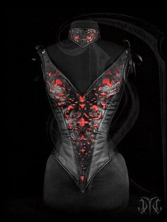 Overbust corset with straps, featuring a gothic styled ornamentation and red satin inlay(http://www.cristianetano.com/en/corsets.html).
