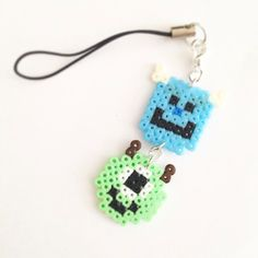 Mike and Sully phonestrap perler beads by pixel_empire Pearler Bead Patterns, Perler Patterns, Pearler Beads, Fuse Beads, Plastic Bead Crafts, Plastic Beads, Cute Crafts, Kid Crafts, Mike And Sulley