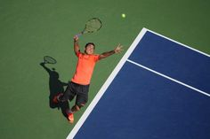 Nicolas Almagro (ESP)[11] serves Philipp Petzschner (GER) in the second round of the US Open. - Mike Lawrence/USTA