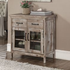 This Storage Console features rustic style recyled fir wood which is perfect for creating e a comfortable environment. With two soft close drawers and two glass doors, this cabinet is as practical for storing accessories as it is stylish.