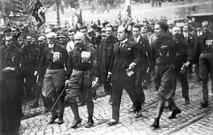The image depicts the March On Rome. In 1922, 30000 fascists marched into Rome, demanding a new government. It was there when he was appointed as Prime Minister. Italians supported Mussolini as their new leader because they thought that under his govern, Italy had political stability. However, this was on behalf of the fact that people who opposed him were severely punished. Eventually, Mussolini allied himself with Adolf Hitler, using him to elevate his leadership during World War II.