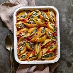 In this healthy stuffed shells recipe, tons of dark leafy chard replaces some of the cheese. Kale and collards are good substitutes for the chard as well. Serve with a salad with Italian vinaigrette. Healthy Stuffed Shells, Cheese Stuffed Shells, Stuffed Shells Recipe, Stuffed Pasta, Healthy Casserole Recipes, Baked Pasta Recipes, Cooking Recipes, Healthy Recipes, Healthy Meals