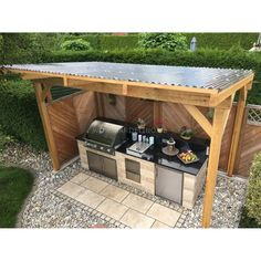 Self-built, covered outdoor stone kitchen with Napoleon built-in barbecue and kitchen.Self-built, covered outdoor stone kitchen with Napoleon built-in barbecue and hob // outdoor kitchen build ideas // selfmade outdoor kitchen out of st. Build Outdoor Kitchen, Outdoor Kitchen Countertops, Backyard Kitchen, Outdoor Kitchen Design, Diy Kitchen, Backyard Bbq, Summer Kitchen, Kitchen Decor, Out Door Kitchen Ideas