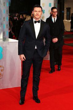 Pin for Later: Stars Go All Out on the BAFTA Awards Red Carpet in London Luke Evans
