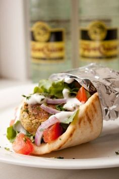 Baked Falafel with Lemon Tahini Sauce - I'd just omit feta to make it vegan. Looks delicious - thanks @Keri Welch!