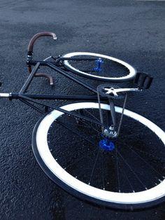matte black bike brown leather tape handles white wheels