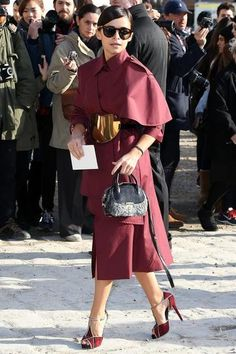 100 best dressed of 2014 - Miroslava Duma arriving at Louis Vuitton Paris Fashion Week in a monochromatic wine colored trench coat with gold belt + matching heels