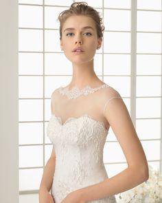 DARIO vestido de novia en chantilly pedrería y organza de seda.