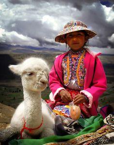 Peru - girl with baby alpaca
