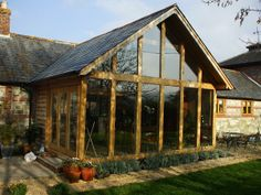 Each building is individually designed, manufactured in our English workshops, delivered to & erected on site. We create truly unique Oak & Glass buildings. Oak Framed Extensions, House Extensions, Timber Window Frames, Glass House Design, Cottage Extension, Timber Logs, Oak Framed Buildings, Glass Building, Porche