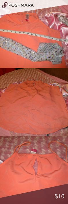 """No Boundaries Peach Top This is in excellent used condition. No rips, tears, stains, etc. that I noticed. Zoom in to check pics before purchasing. Item sold as-is--no refunds, returns, exchanges, lawsuits, riots, marches, rallies, etc. Seriously, I described this item to the best of my ability but please check pics & ask questions! WILLING TO NEGOTIATE--Feel free to send an offer. I don't call ppl out for so called """"low-ball"""" offers. TY Yaya No Boundaries Tops Tank Tops"""