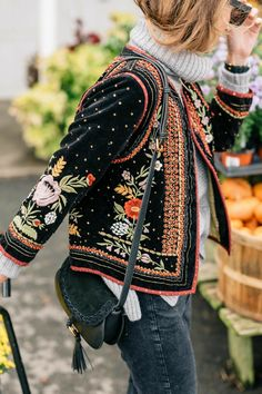 embroidered etno style jacket, folk inspired embroidery on a jacket, gray chunky turtleneck sweater, green suede crossbody bag, embroidered velvet jacket,
