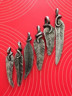 Hand forged leaf pendants, made at Laurieton Men's Shed.