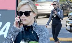 Reese Witherspoon clutches green juice as she steps out in gym gear