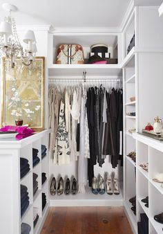 Walk in closet arranged by colour palette/story/item type ie. jeans etc..