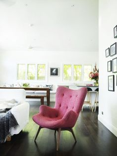 Possible accent chair design (One mid century accent chair in the living room upholstered in pink wool.) <-- wouldn't want pink or wool... but interesting shape