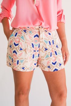 Geometric print pants or shorts in bright colors and non-neutral blouses.