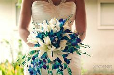 Blue orchid and white lilly bouquet from The Flowergirl 912-489-5511 www.facebook.com/jackiesflwrshop