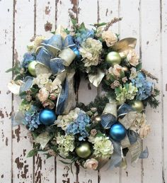Cream and Dusty Blue Hydrangea, Cream Garden Roses, Gold Berries,  Light Green and Blue Balls, Gold Bow and Blue Sheer Dot Bow/Hol81