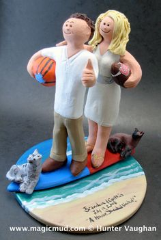North Carolina Tarheels Wedding Cake Topper, Surfers Wedding Cake Topper, Basketball Wedding Cake Topper, South Carolina Wedding Cake Topper    Perfect for the marriage of a Surfer Groom and his Bride! The photographs in this listing are but an example of what we will create for you....simply email or call toll free with your own info and pictures of yourselves, and we will sculpt for you a treasured memory from your wedding!    $235 #magicmud 1 800 231 9814 www.magicmud.com