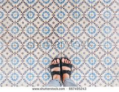 Top view of selfie feet in sandals shoes standing on seamless floor background with copy space