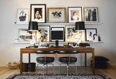 photo display on shelves behind desk