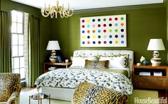 The master bedroom's silk Donghia wallcovering anchors a Damien Hirst print and chairs in Scalamandré's Leopardo.