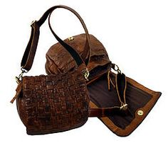 The LWM-462 Woven leather handbag makes to a tactile take on the ever-chic hobo silhouette. Shoulder strap 150cm. Zip compartment on the back. Fabric lining 26cm W X 23cm H. 100% Leather.