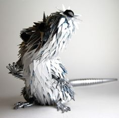 Sean Avery, is an Australian artist who turns discarded CDs into beautiful and striking animal sculptures