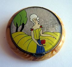 Art Deco Amber Bakelite or Celluloid French Regency Lady Glitter Compact 1920s sold for £304.99