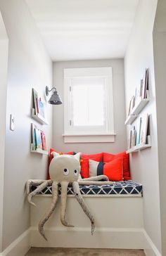 Create a colorful children's reading nook in a small corner or a window seat.  Add shelves, wall lighting and colorful pillows. From 6th Street Design School