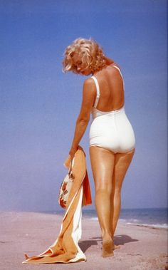 Marilyn Monroe in 1950s white swimsuit.  pinup style vixen.