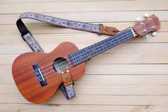 All Qilin Guitar&Ukulele Strap are handmade in Thailand by a passionate and we love guitar and musical instrument . We start from the beginning from sourcing, selecting until finishing our products. We only use genuine leather and high quality materials, carefully crafted in every detail to proudly present you the Ukulele Strap that your Ukulele or Acoustics Guitar deserve. Ukulele Strap Product including: 1 Ukulele Strap, 1 Hood, 1 Leather Rope Ukulele Strap can be 3 pattern in 1 Strap ...