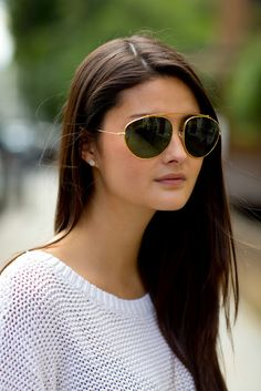 Long hair, white knit and cool glasses.