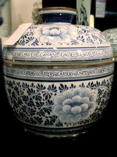Elegant blue and white Asian styled vase- will pull the blue of the artwork and walls into the room subtly.