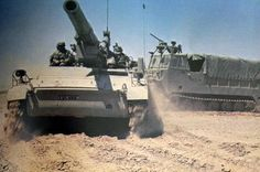 "Israeli 203mm self-propelled gun M110 ""Romach"", next to ammunition transporter M548."