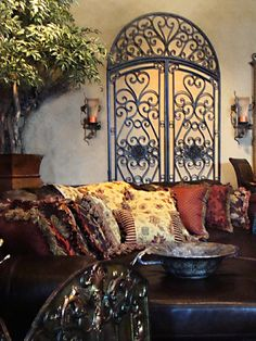 If you are having difficulty making a decision about a home decorating theme, tuscan style is a great home decorating idea. Many homeowners are attracted to the tuscan style because it combines sub… Wine Bottle Display, Decor, Wrought Iron Wall Decor, Italian Decor, World Decor, Wrought Iron Decor, Home Decor, Tuscan Decorating, Iron Wall Decor