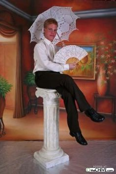 Funny Senior Pictures - You know what a good accessory to match the lace umbrella is?  This wonderful fan.