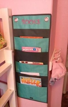 Use a thirty one hang up family organizer for books or even magazines hanging on the back of the door in the bathroom!