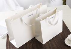 white craft carrier bag, white cotton strap handles carrier bag, premium paper bag, special glossy paper bag, luxury paper bag